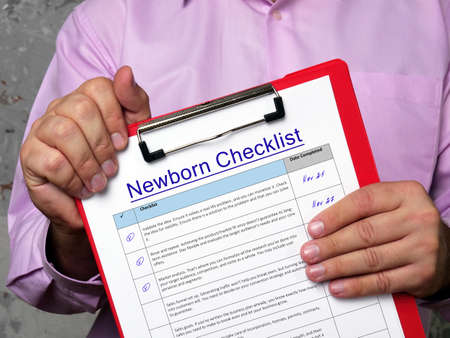 Financial concept about Newborn Checklist with sign on the sheet. Banque d'images