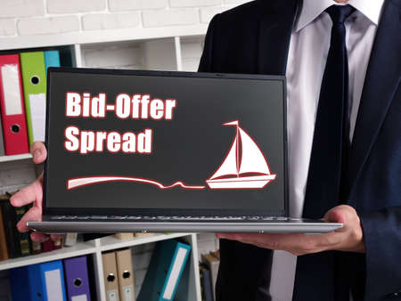 Business concept about Bid-Offer Spread with inscription on laptop. Zdjęcie Seryjne