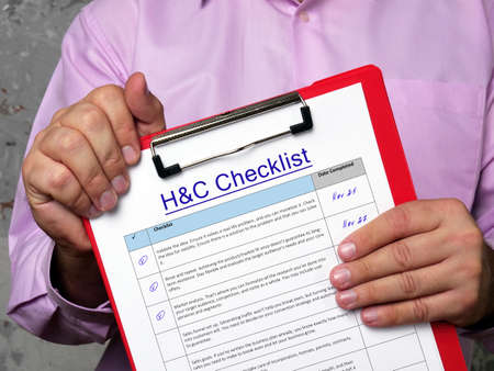 Financial concept about Humanitarian and Compassionate Considerations H&C Checklist with phrase on the piece of paper. Stock Photo