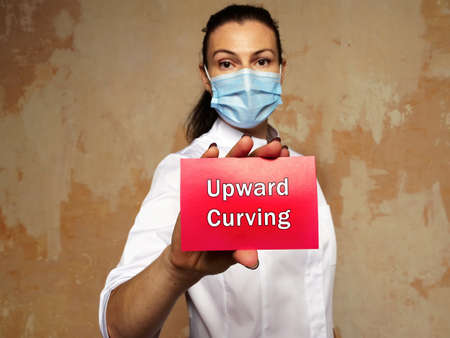 Medical concept meaning Upward Curving with phrase on the piece of paper.