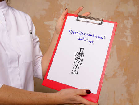 Medical concept about Upper Gastrointestinal Endoscopy with phrase on the piece of paper.