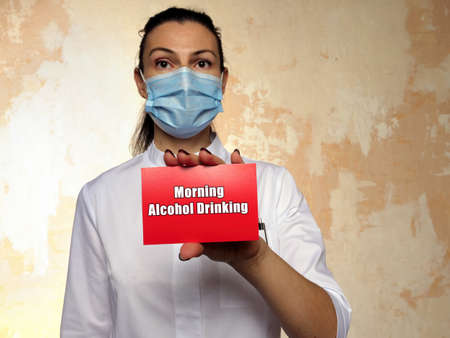 Medical concept meaning Morning Alcohol Drinking with inscription on the sheet.