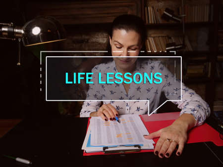 LIFE LESSONS text in block of quotes. Modern Banker doing paperwork A lesson which conveys something instructive or valuable about life or principles for living one's life.