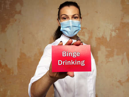 Healthcare concept about Binge Drinking with sign on the sheet.