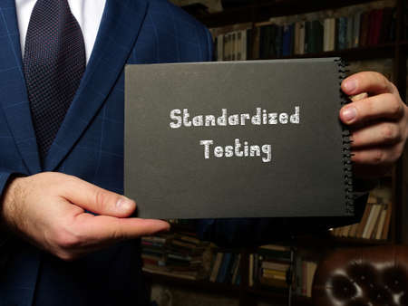 Juridical concept about Standardized Testing with inscription on the piece of paper.
