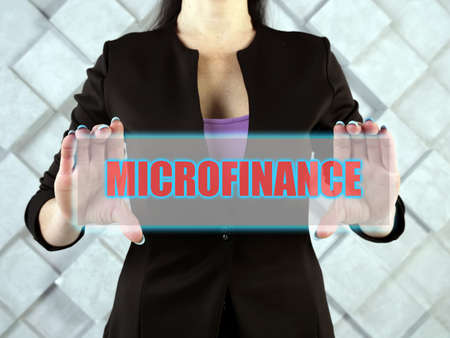 MICROFINANCE phrase on the screen. A banking service provided to unemployed who otherwise would have no other access to financial services Standard-Bild