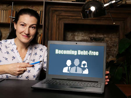Financial concept meaning Becoming Debt-Free with inscription on laptop. Stock Photo
