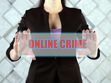 ONLINE CRIME text in virtual screen. Cybercrime, or computer-oriented crime, is a crime that involves a computer and a network.