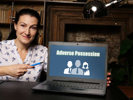 Business concept meaning Adverse Possession with sign on laptop.