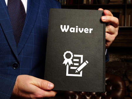 Juridical concept about Waiver with sign on the piece of paper.