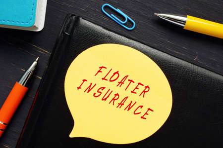 Business concept meaning FLOATER INSURANCE with sign on the business paper