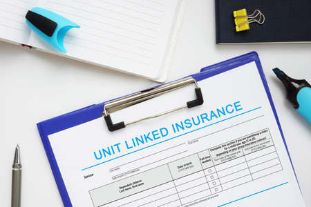 Financial concept about UNIT LINKED INSURANCE with sign on the business paper