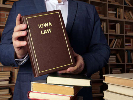 IOWA LAW inscription on the book. The Iowa Code contains all permanent laws that are passed by the Iowa General Assembly and signed by the Governor.
