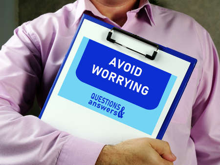 Conceptual photo about AVOID WORRYING with handwritten text.