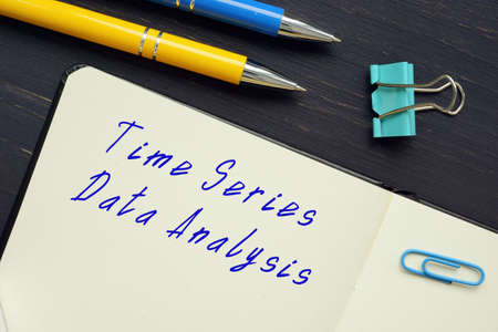 Financial concept meaning Time Series Data Analysis with inscription on the piece of paper.