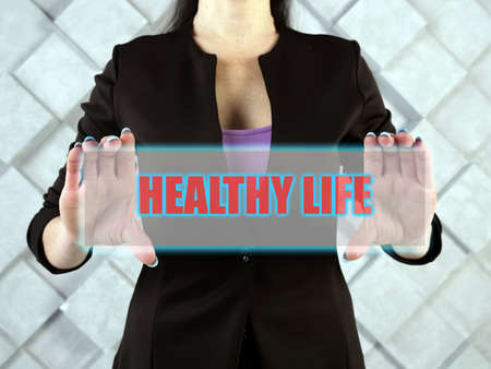 HEALTHY LIFE text in futuristic screen. A healthy lifestyle is one which helps to keep and improve people's health and well-being. 写真素材