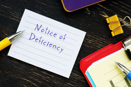 Notice of Deficiency sign on the page.