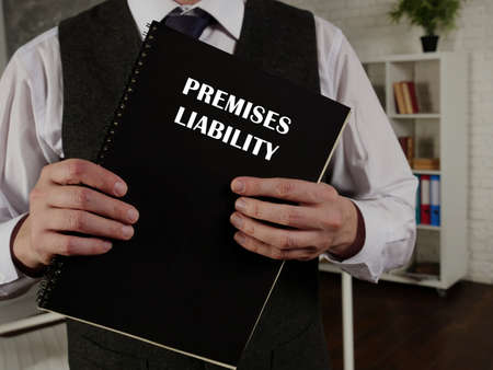 Lawyer holds PREMISES LIABILITY book. Premises liability is the liability that a landowner or occupier has for certain torts that occur on their land