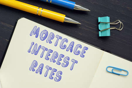 Business concept about MORTGAGE INTEREST RATES with sign on the sheet.