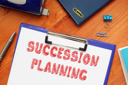 Financial concept about SUCCESSION PLANNING with sign on the piece of paper.
