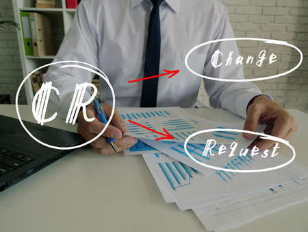 Conceptual photo about CR Change Request with handwritten phrase. Senior Man Checking A Document on background.