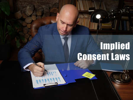 Business concept about Implied Consent Laws. Closeup portrait of unrecognizable successful businessman wearing formal suit reading documents