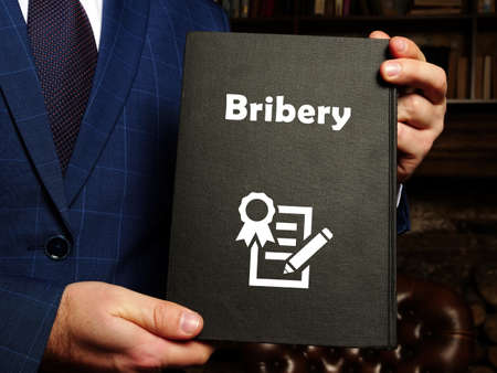 Legal concept meaning Bribery with phrase on the sheet.