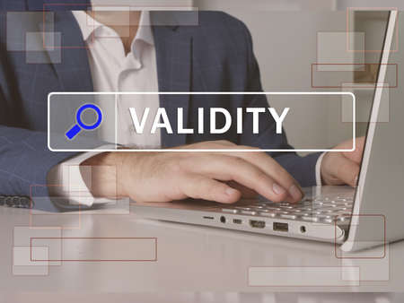master business administration VALIDITY text in search line. Modern Banker looking for something at computer. master business administration VALIDITY concept.