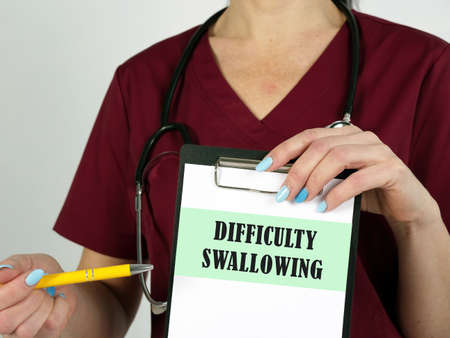 Healthcare concept meaning DIFFICULTY SWALLOWING with inscription on the piece of paper.