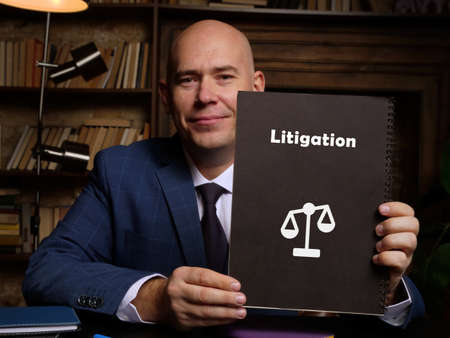 Legal concept about Litigation with sign on the piece of paper. Reklamní fotografie