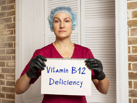 Healthcare concept about Vitamin B12 Deficiency with phrase on the sheet.