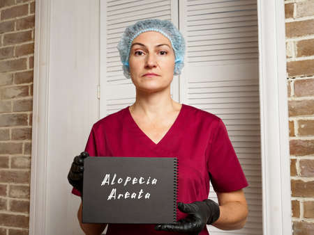 Medical concept meaning Alopecia Areata with phrase on the page. Standard-Bild