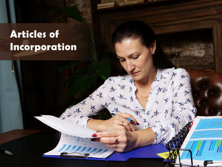 Business concept about Articles of Incorporation. Closeup portrait of unrecognizable successful Businesswoman wearing formal suit reading documents