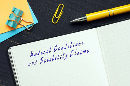 Juridical concept about Medical Conditions and Disability Claims with inscription on the page. Reklamní fotografie