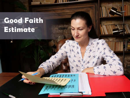 Good Faith Estimate Businesswoman, executive manager hand filling paper business document Reklamní fotografie