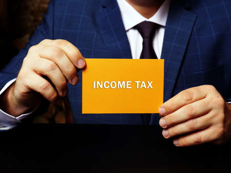INCOME TAX phrase on the page. Aa type of tax that governments impose on income generated by businesses
