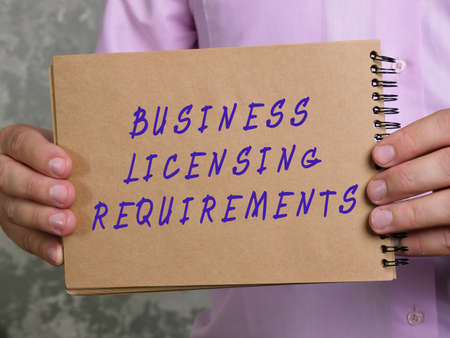 Financial concept about BUSINESS LICENSING REQUIREMENTS with inscription on the sheet.