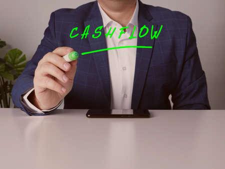 Loan officer writing CASHFLOW with marker