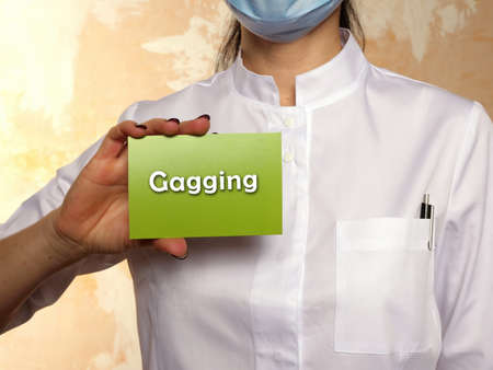 Conceptual photo about Gagging with handwritten text. Stock Photo