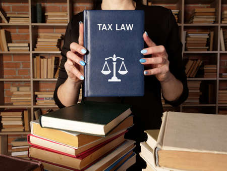 Book with title TAX LAW. It covers the rules, policies and laws that oversee the tax process, which involves charges on estates, transactions, property, income, licenses and more