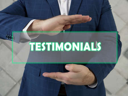 TESTIMONIALS text in futuristic screen. A testimonial is a written statement about a person's character and abilities Stock Photo