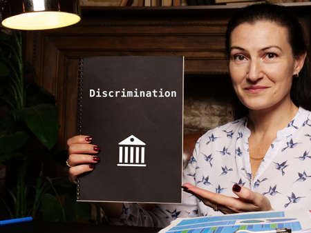 Juridical concept about Discrimination with phrase on the sheet. Reklamní fotografie