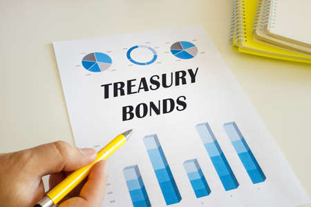 Financial concept about TREASURY BONDS with sign on the printout with diagrams and tables.