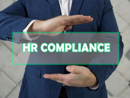 HR COMPLIANCE human resources text in futuristic screen. HR compliance is a process of defining policies and procedures to ensure your employment