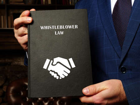WHISTLEBLOWER LAW inscription on the sheet. As a whistleblower you're protected by law - you should not be treated unfairly or lose your job because you 'blow the whistle'