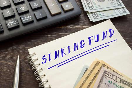Conceptual photo about SINKING FUND with handwritten text. Standard-Bild