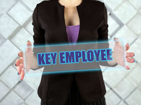 KEY EMPLOYEE text in virtual screen. A key employee is an employee with major ownership and / or decision-making role in the business