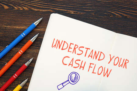 Business concept meaning Understand Your Cash Flow with sign on the piece of paper. 写真素材