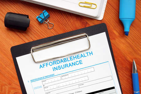 Business concept meaning AFFORDABLEHEALTH INSURANCE with phrase on the bank form
