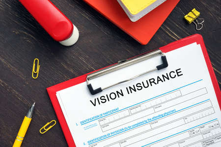 Business concept meaning VISION INSURANCE with inscription on the business paper